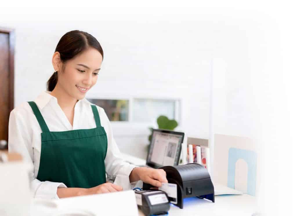 Business woman using backup network internet to run a credit card transaction for customer purchase while primary ISP is down.